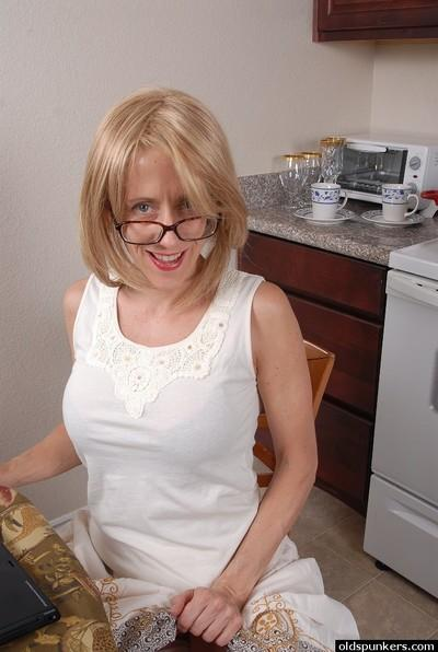 Tattooed mature Charlotte stretches her small asshole in the kitchen