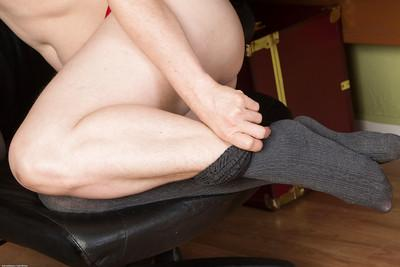 Older hirsute secretary Artimesia sliding hosiery over thong adorned butt