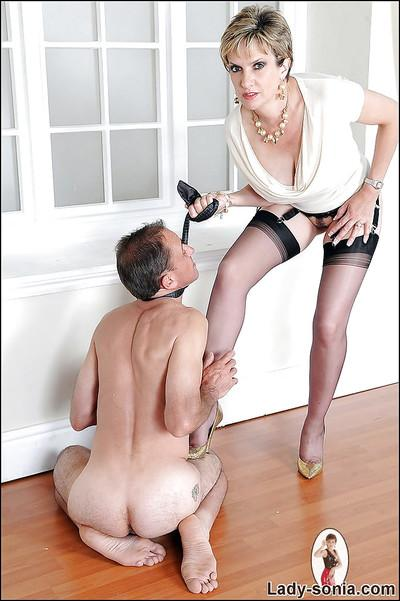Busty femdom lets her tortured manslave lick her ass and high heel shoes