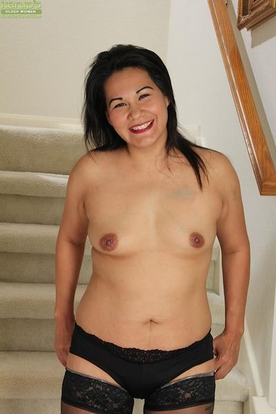 Cute Asian babe Susie Jhonson spreads her tight pussy for a close up