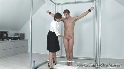 Mature femdom jerks a cumshot out of her tied up male pet