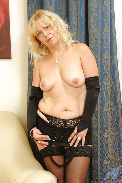 Fat mom in black stockings and sleeves Sara Lynn penetrating herself with a dildo