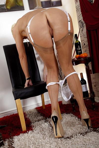 Mature hose and nylon model Jan Burton bends over to flash upskirt undies