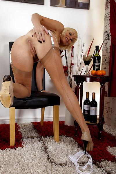Mature hose and nylon model Jan Burton bends over to flash upskirt undies