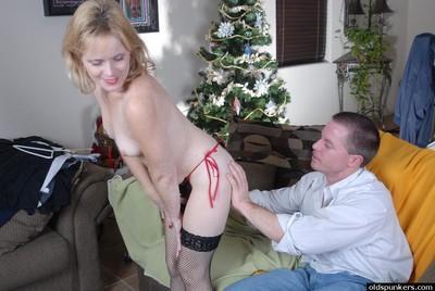 Mature blonde lady Pandora eating cum from hand in hardcore sex scene