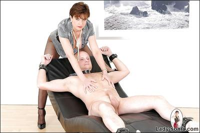 Barely clothed mature femdom in pantyhose teasing her male pet