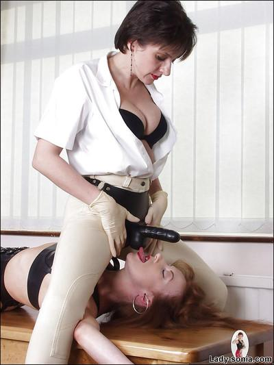 Lascivious fetish lady is into kinky strapon action with her lesbian friend