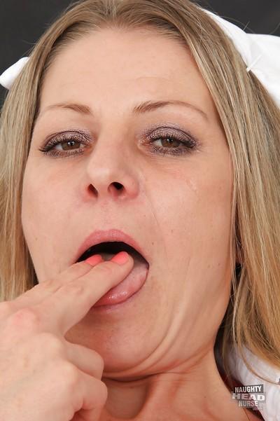 Uniformed nurse Liba reveals her mature shaved pussy in high heels