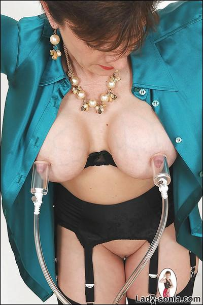 Bound up mature fetish lady with big tits gets her nipples pumped up