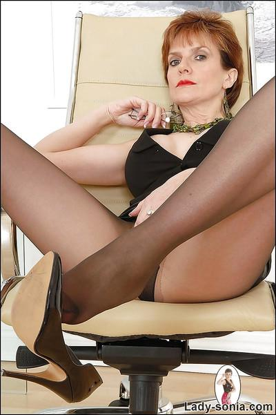 Mature lady in pantyhose spreading her legs and teasing her vag with her shoe