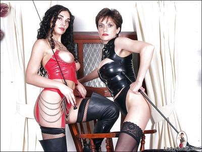 Stunning fetish lady in latex outfit posing with her sexy female friend