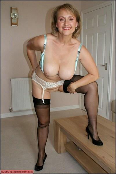 Mature blond fatty in stockings fucking her shaved twat with a dildo