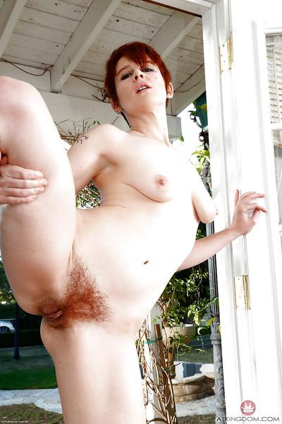 Older redhead lady Lily Cade spreading ginger pussy and ass outdoors