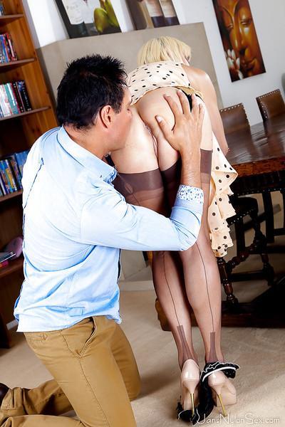 Blonde cougar Jan Burton having her panties pulled down for oral sex