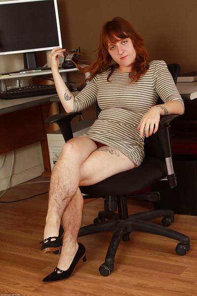 Hirsute secretary Velma flashes panties from under dress at work