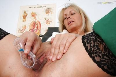 Lustful mature blonde playing with a glass dildo and pissing