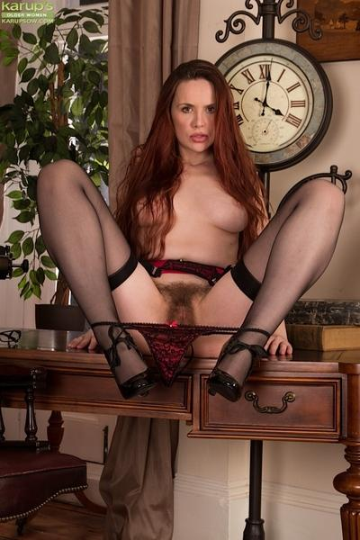 Beaver pussy MILF taking off her stockings and black lingerie