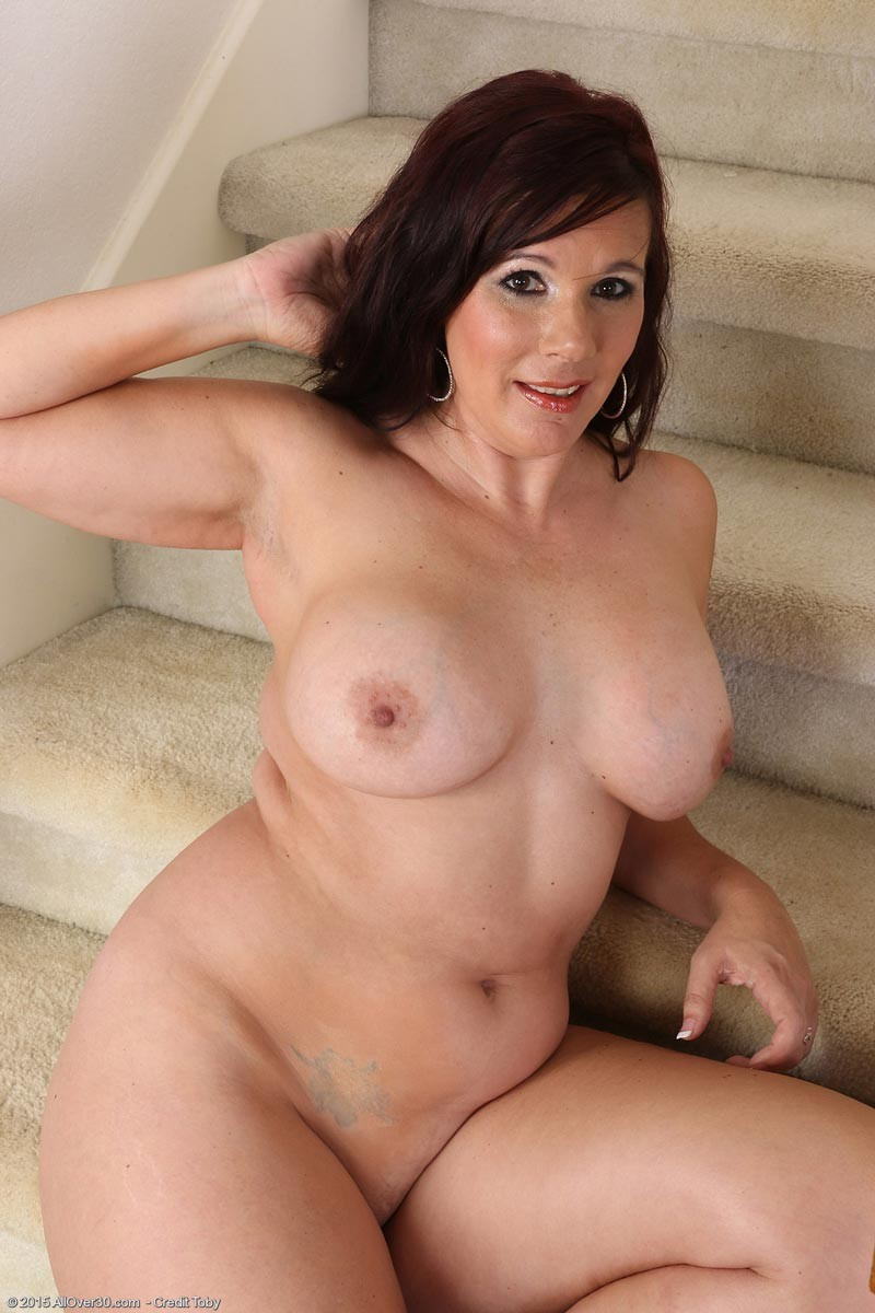 Busty mature strips on stairs