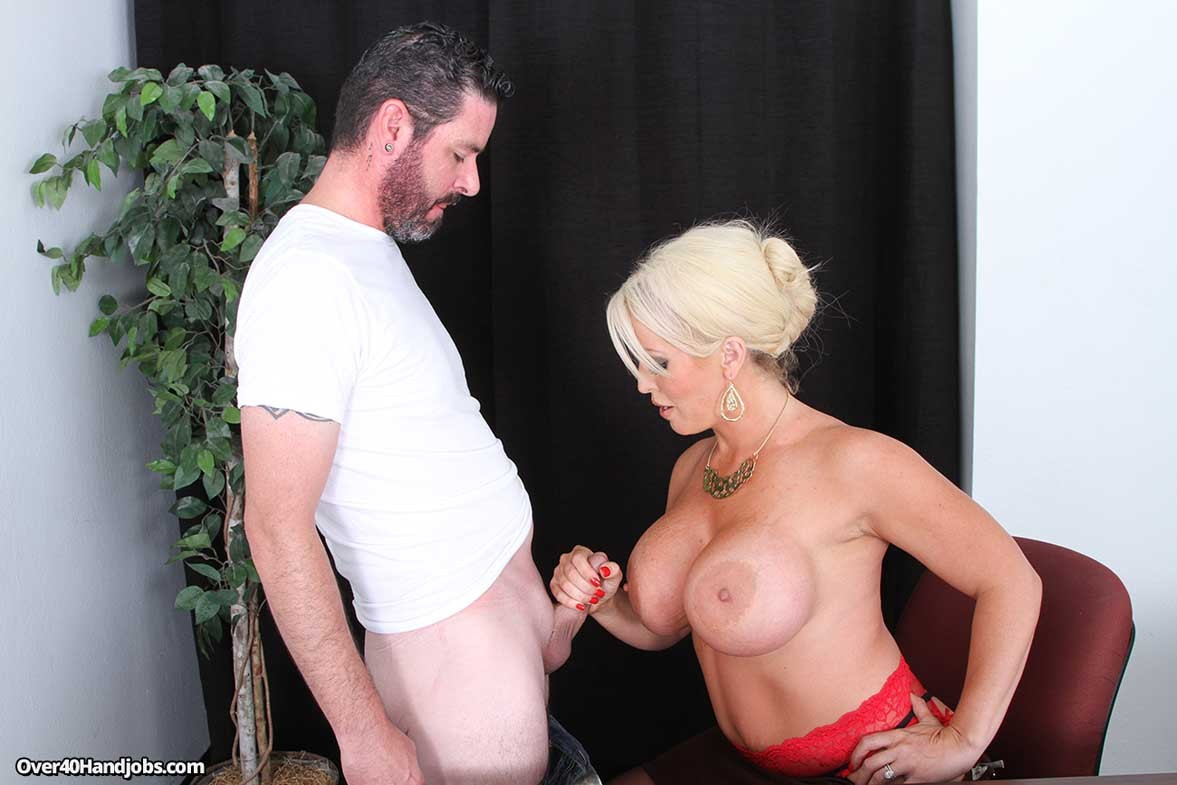 Busty blond milf alura jenson jerking cock with her tits