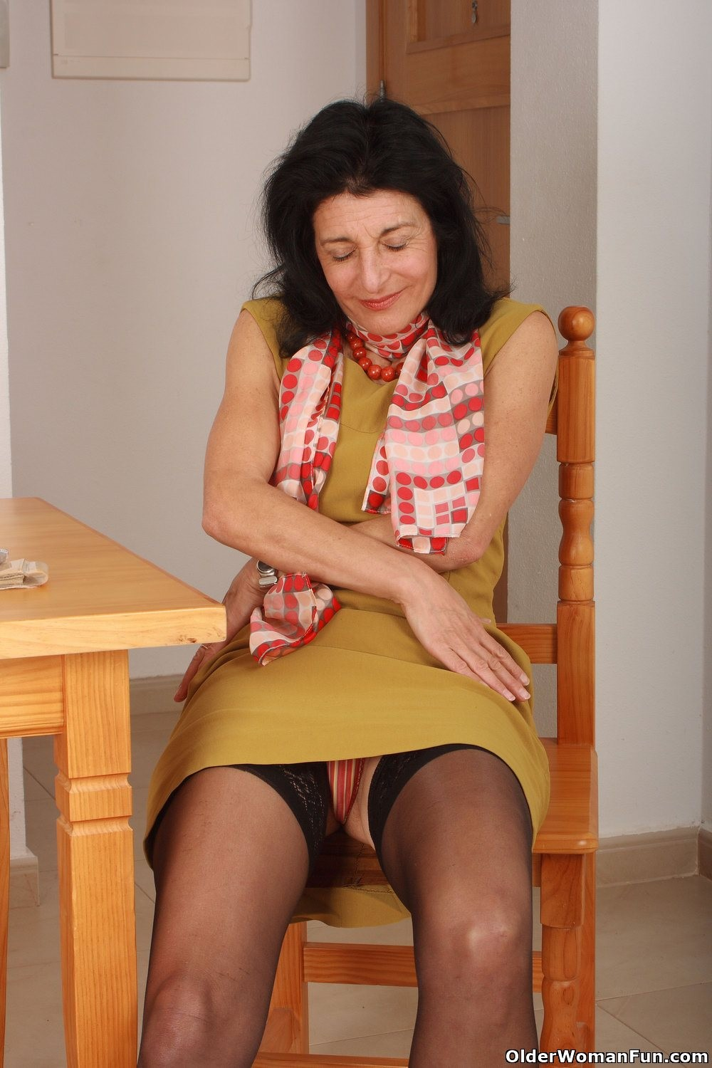 Granny emanuelle wears stockings and masturbates