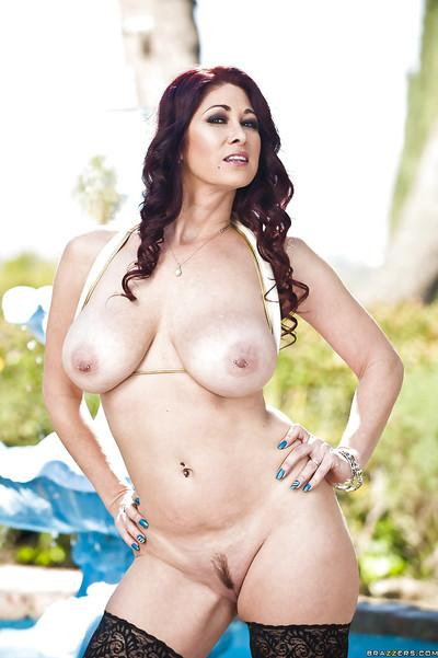 Lusty MILF in bikini and black stockings Tiffany Mynx posing outdoor