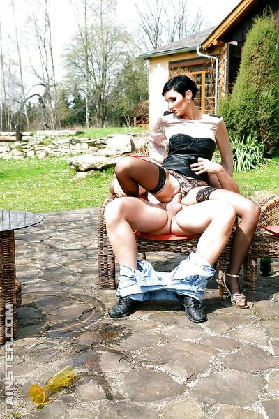 Glamourous MILF Gabrielle Gucci enjoys fully clothed sex outdoor