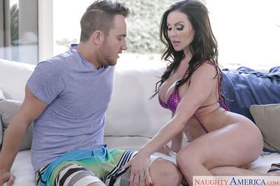 Busty MILF pornstar Kendra Lust giving big cock blowjob in bikini