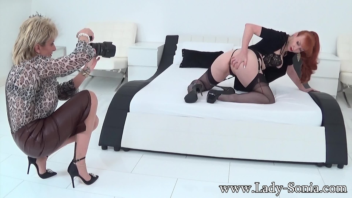 Blonde and redhead milfs in hot lesbian action