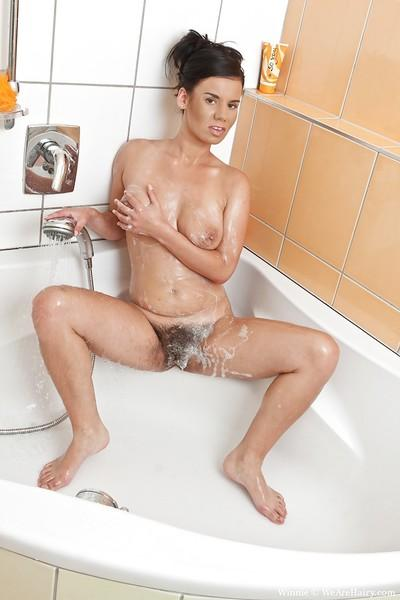 Sexy MILF with big tits Winnie stripping and taking a shower