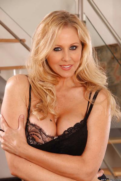 Blonde MILF with big tits Julia Ann stripping off her dress and lingerie
