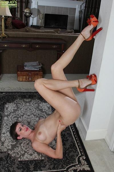 Skinny short haired brunette solo girl Stevie Jones baring small MILF boobs