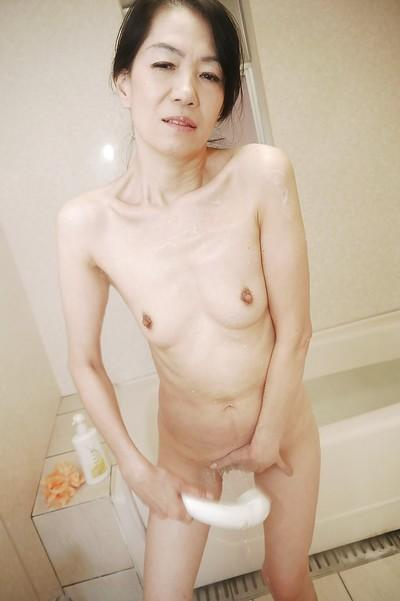 Oriental MILF beauty Yukiko Asaba bathing her hairy Asian pussy