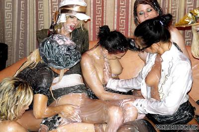 Lewd fetish ladies enjoy a wild and messy lesbian orgy at the house party