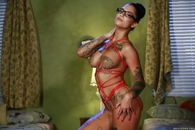 Big tits milf babe with sexy tattoos Bonnie Rotten poses in glasses