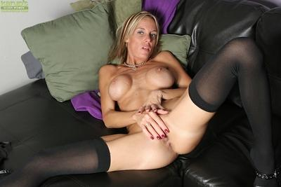 Blonde MILF Armani Knight posing for sexy lingerie photo shoot