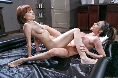 Lesbians Adessa Winters and Ariella Ferrera oil each other up for tribbing