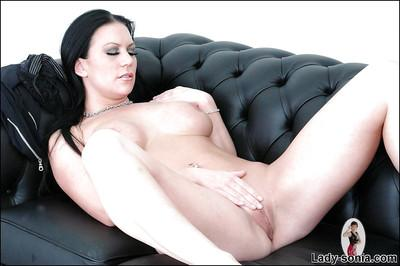 Saucy mature vixen taking off her sport outfit and masturbating her slit