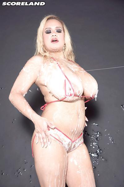 Buxom blonde MILF Liza Biggs shows off huge hooters after bukkake session