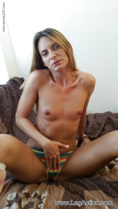 Spreading wide her longs legs milf Madison B uses a toy on her pussy
