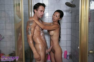Ducky Asian milf Tia Ling gets soaked at the sight of big dong