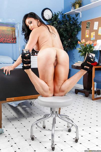 Voluptuous nurse Audrey Bitoni stripping and spreading her legs