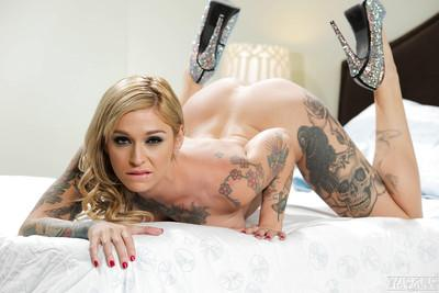 Tattooed MILF Kleio Valentien removes black dress to masturbate bald cunt