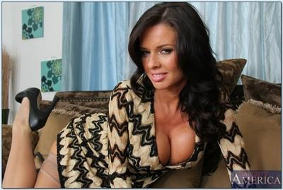 Seductive MILF Veronica Avluv stripping off her dress and lingerie