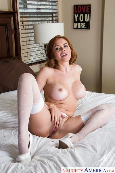 Milf babe in stockings Krissy Lynn proudly squeezes her large boobs