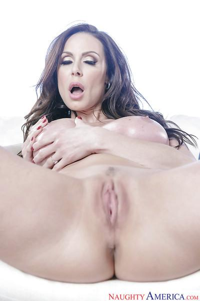 Brunette MILF babe Kendra Lust freeing big tits and ass from bikini