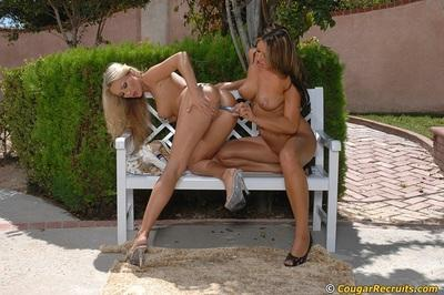 Carmen McCarthy & Diana Doll perform a sizzling lesbian scene outdoor