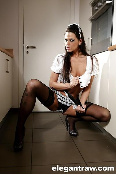 European maid Simony Diamond posing in kitchen wearing uniform and nylons