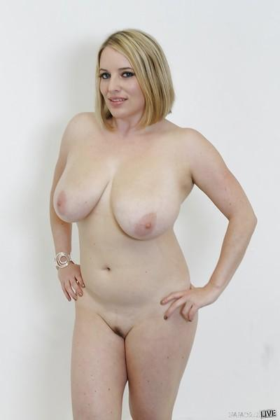 Blonde milf Maggie Green reveals her fatty big tits in a red skirt