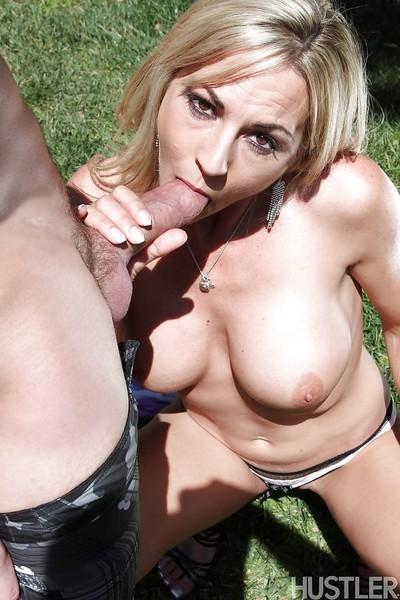 Busty blonde MILF pornstar Sindy Lange deepthroating cock outdoors