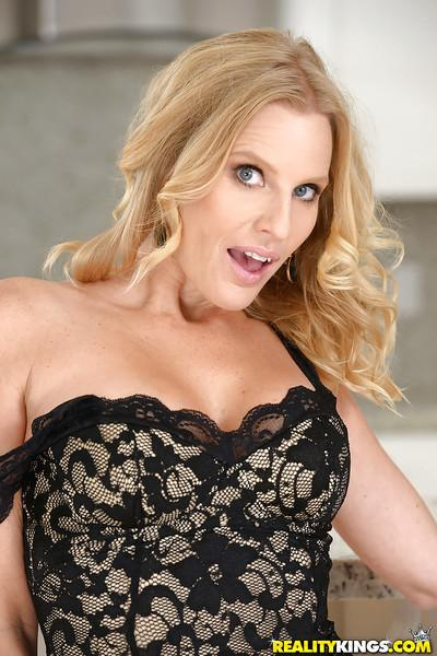 Busty blonde wife Brianna Ray freeing big natural tits from lingerie